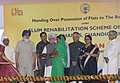 Manmohan Singh handing over the possession of flat to one of the beneficiary under Slum Rehabilitation Scheme of JNNURM, at Dhanas, Chandigarh. The Governor of Punjab, Shri Shivraj Patil, the Governor of Haryana.jpg