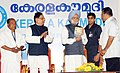 "Manmohan Singh releasing the history book of Kerala ""Kaumudi"" at the centenary celebrations of Kerala Kaumudi Publications Limited, at Kanakakkunnu Palace, Thiruvananthapuram, in Kerala on February 12, 2011.jpg"