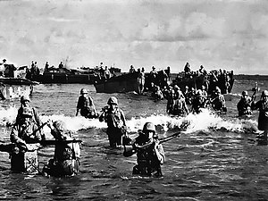 Battle of Tinian - U.S Marines wading ashore on Tinian.