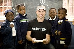 Matt Dawson in Johannesburg with pupils of a UNICEF-funded school.