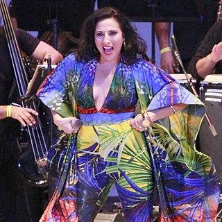 Melina Almodovar Puerto Rican salsa singer/songwriter, dancer, and entertainer
