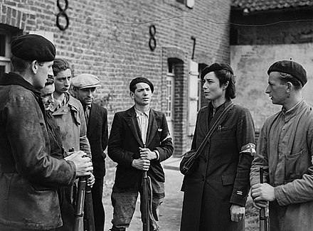 A group of resistants at the time of their joining forces with the Canadian army at Boulogne, in September 1944. Members of the Maquis in La Tresorerie.jpg