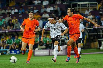 Joris Mathijsen - Mathijsen battling for the ball with Germany's Mesut Özil at Euro 2012.