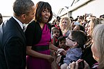 Michelle Obama talking with people along a ropeline, 2013.jpg