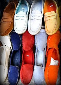 Positano ( Italy ): multicolour moccasins for sale.