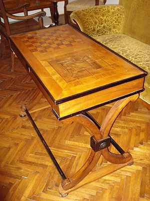 Nine Men's Morris - An old combined Nine Men's Morris and chess table