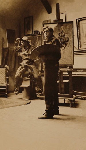 N.C. Wyeth in his studio with a cowboy model