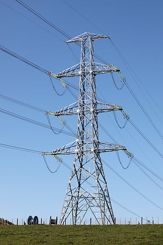 Electric power - Electric power is transmitted on overhead lines like these, and also on underground high-voltage cables.