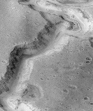 Chronology of discoveries of water on Mars - Inner channel (near top of the image) on floor of Nanedi Valles that suggests that water flowed for a fairly long period. Image from Lunae Palus quadrangle.
