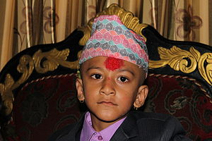 Dhaka topi - Nepali kid wearing a Nepali Dhaka topi.