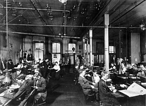 Newsroom - Reporters, editors and staff at work in the newsroom of The Times-Picayune, 1900