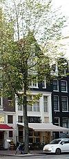foto van Pakhuis met puntgevel en hoge houten pui