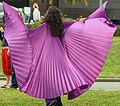 Nikki Nez twirling in purple at a God is Love gathering in SF's Golden Gate Park.jpg