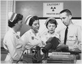 Nuclear Nursing - Chief Hospitalman Lee Jones, U.S. Navy, of Silver Spring, Maryland, demonstrates radiation survey... - NARA - 521004.tif
