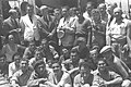 "OFFICIALS OF THE JEWISH AGENCY, AMONG THEM MOSHE SHAPIRA (STANDING 3RD FROM LEFT) RECEIVING IMMIGRANT REFUGEES FROM EUROPE ON BOARD OF THE ""MATAROA"" ID7-126.jpg"
