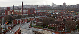 Chadderton - Chadderton has a post-industrial landscape which forms a continuous urban area with Oldham (pictured on the horizon) and Manchester. This view is over Broadway in central Chadderton.