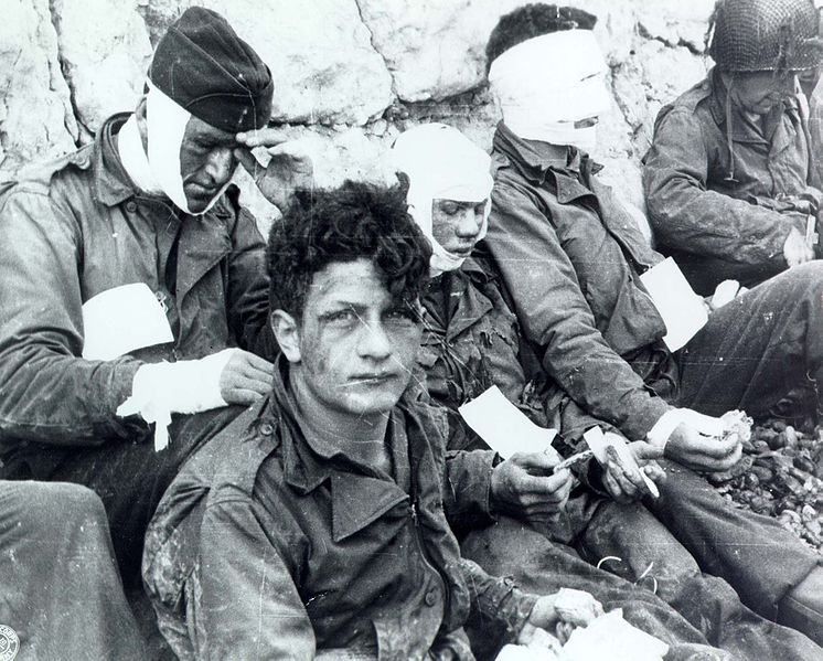 File:Omaha Beach wounded soldiers, 1944-06-06 SC 189910-S.jpg Description	 English: American assault troops of the 3d Battalion, 16th Infantry Regiment, 1st U.S. Infantry Division, who stormed Omaha Beach. Colleville-sur-Mer, Normandy, France, 6 June 1944.