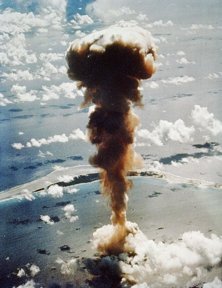 Aerial view of the Operation Crossroads Able mushroom cloud rising from the lagoon with the Bikini Island visible in the background Operation Crossroads - Able 001.jpg