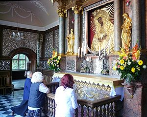 Marian devotions - Praying beforeOur Lady of the Gate of Dawn in Vilnius, Lithuania