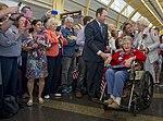 Patrons of Ronald Reagan Washington National Airport greet a 101-year-old Army veteran.jpg