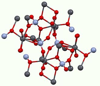 Monazite - Structure of monazite.  Color scheme: red = oxide, pale blue = P, dark gray = Ce(III) and other lanthanides and actinides.