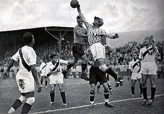 Football in Peru - Juan Valdivieso, goalkeeper of the Peru national football team, reaches out for the football during the 1936 Berlin Summer Olympics match between Austria and Peru.