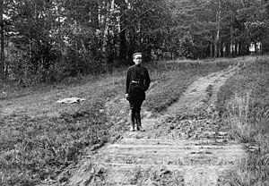 Peter Ermakov - Ermakov standing on the hidden grave of the Tsar and his family.