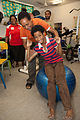 Physiotherapist Saimonah Mokupe assisting clients using AusAID donated equipment (10713163616).jpg