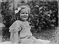Portrait of a toddler girl seated on the grass (AM 85181-1).jpg