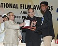 Pranab Mukherjee presenting the Rajat Kamal Award for Best Child Artist (Shared) Fandry Meengal (Marathi) to Somnath Avghade, at the 61st National Film Awards function, in New Delhi. The Secretary.jpg