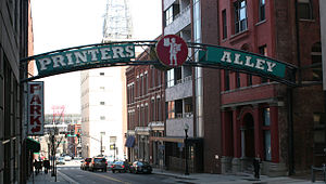Printer's Alley - A large sign marks the entrance to Printer's Alley on Church Street.