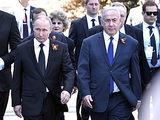 Ribbon of Saint George - Vladimir Putin and Benjamin Netanyahu wearing the Ribbon of Saint George, at Victory Day 2018