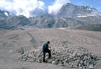 Pyroclastic flow - A scientist examines pumice blocks at the edge of a pyroclastic flow deposit from Mount St. Helens