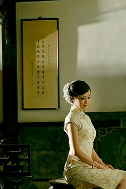 582c769870 Qipao woman.jpg. A woman in a cheongsam. Type, Dress. Material, Silk, cotton.  Place of origin, China