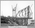 Queensland State Archives 3628 Main bridge erection stage 3 tower traveller lifting upper vertical of fourth panel Brisbane 16 March 1938.png