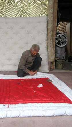 Quilter and quilting in the Bazaar of Nishapur 08.JPG