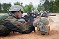 RFN Lokendra Budhathoki sights in an M4 carbine while familiarizing himself on the American weapon.jpg
