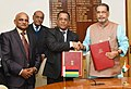 Radha Mohan Singh and the Minister of Business Enterprise and Cooperatives of Mauritius, Shri S. Bholah after signing an MoU between India and Mauritius for cooperation in the field of cooperatives & allied sectors.jpg