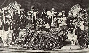Kingdom of Nepal - Rani (Queen) of Nepal surrounded by her Ladies-in-Waiting, 1920