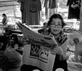 Reading woman, Mae Phim market. Thailand (23520474102).jpg