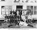 Renzoni and Regina hockey teams posed with their equipment in front of the Dawson Amateur Athletic Association building, Dawson (AL+CA 2761).jpg
