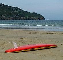 surfboard fin on beach