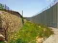 Retaining wall next to Israeli separation barrier, Bethlehem.jpg