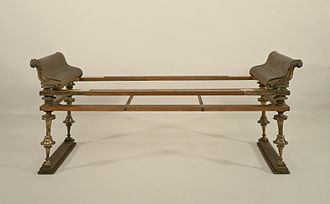 Ancient furniture - A Roman dining couch or klinē, in metal and reconstructed wood, from a tomb