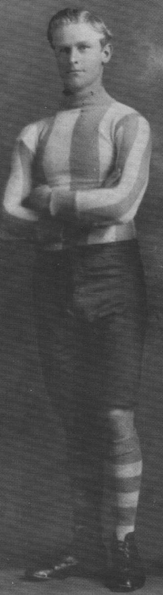"North Melbourne Football Club - Syd Barker, Sr., club legend and star ruckman of ""The Invincibles"" era."