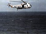 SH-3H Sea King of HS-4 with sonar deployed in flight 1983.jpg