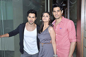 Varun Dhawan - Dhawan with Sidharth Malhotra (right) and Alia Bhatt (center) promoting Student of the Year in 2012