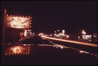 """STREAKS FROM AUTOMOBILE LIGHTS ON """"THE STRIP"""" AT NIGHT BEGINNING AT BAGNELL DAM, """"THE STRIP"""" WINDS FOR A MILE OR SO... - NARA - 551321.tif"""