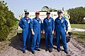 STS-135 crew in front of their M113 armored personnel carrier.jpg