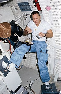 STS-5 Overmyer eats on middeck.jpg